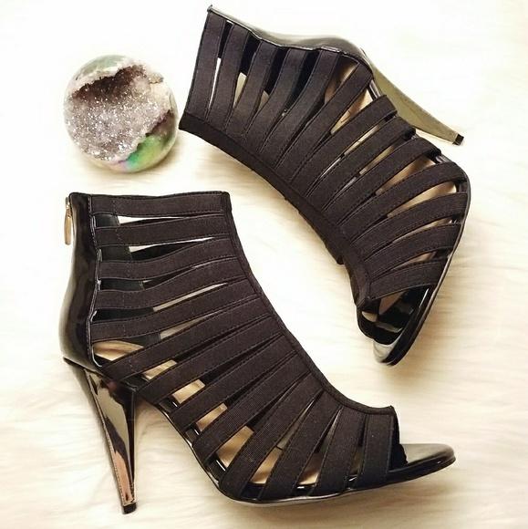 04a08ded643 Black Gladiator Strappy Caged Heels. M 5a965e298af1c534e7962a32